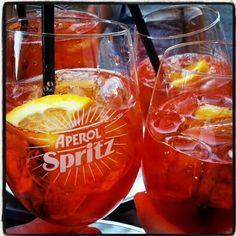 Aperol Spritz - Aperol, Prosecco & sparkling water with a slice of orange on ice - DELISH!