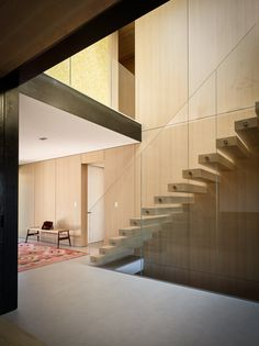 Staircase, Glass Railing, and Wood Tread A grand staircase was transformed into a floating cantilevered structure, bringing natural light into the lower rooms.    Photo 2 of 16 in This Renovated Esherick Perfectly Frames the San Francisco Bay