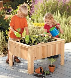 Kids raised box planter. GREAT idea for growing on the deck!