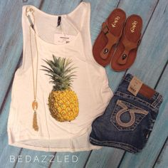 We are loving this pineapple tank! Stop in today and grab one before they are gone! Tank $18.99 small-large Big star shorts $98.00  Sandals $18.99 (limited sizes) Necklace $21.99 #bedazzledokc