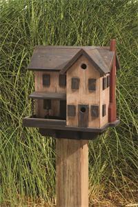 This birdhouse and birdfeeder has a unique primitive look.