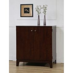 <li>Improve your home office decor with this Compact computer cabinet <li>Furniture features a dark walnut finish <li>Cabinet also features a pull-out keyboard tray