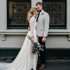 Long sleeve wedding dress and casual ponytail hair style