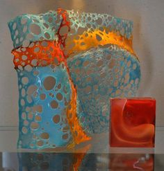 """Two Waves, Open and Closed  8""""x10""""x4"""" and 3""""x3""""x1"""".  Two separate fused glass processes. ©Linda Humphrey / KilnForms."""