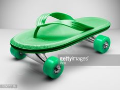 Stockfoto : Beach shoe attached to skateboard wheels