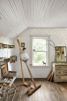 "What a stunning home art studio! ""This is the room that made us want the house the most, but we joke that it's probably what scared everyone else away,"" says Lindsea with a laugh. ""The floors are wavy and wonky. It looks like an abandoned space, but the light is so pretty. You can see the mountains and an evergreen Northwestern scene from the window."""