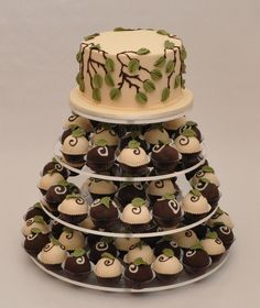 Truffles Cake and cupcakes with white and dark chocolate with green leaves cake decor.PNG