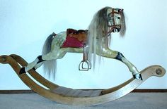 English rocking horse made by the Stevenson Brothers 1990, number 642, Height 93cm, Length 1,70m,