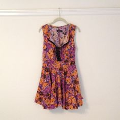 Ay Not Dead Floral Dress Gorgeous bright abstract floral dress that laces up the front. Has a full skirt and lots of stretch. Worn only once. Ay Not Dead Dresses