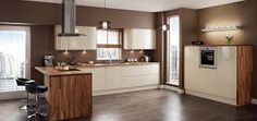 mid height wall oven cabinet with feature timber surround