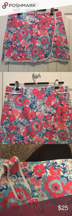 """Lilly Pulitzer cotton skort Pink, blue, and white patterned Lilly Pulitzer faux wrap skort. Size 6. Fits true to size. Worn with no stains. 14"""" from top to bottom lace trim.Overall good condition. Lilly Pulitzer Shorts Skorts"""