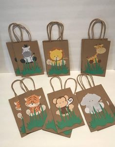 """These adorable Safari favor bags are a special addition to your safari themed party  They are great for candy table decoration, and they make special thank you party favor.  12 Goodie Bags (2 of each character)  Bags are 8""""H (without handles) X 5"""" W  Example: If purchasing 15 bags you have to add"""