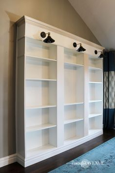 Want to know how to build your own library wall? I started with 3 ikea billy boo… Want to know how to build your own library wall? I started with 3 ikea billy bookcases and modified them to look custom! Read on as I share all the details! Ikea Billy Bookcase Hack, Bookshelves Built In, Built Ins, Billy Bookcases, Diy Bookshelf Wall, Ikea Billy Hack, Diy Wall, Bookshelf Lighting, Custom Bookshelves