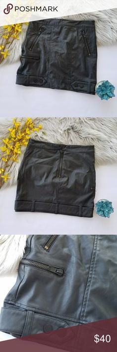 H&M Pleather Skirt Black faux leather mini skirt with zippers and a button belt detail around the bottom. Zipper with a v cut on the back. Size 6. H&M Skirts Mini