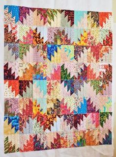 Another great scrap buster quilt. Think this is a Bonnie Hunter pattern, great quilt by hope54