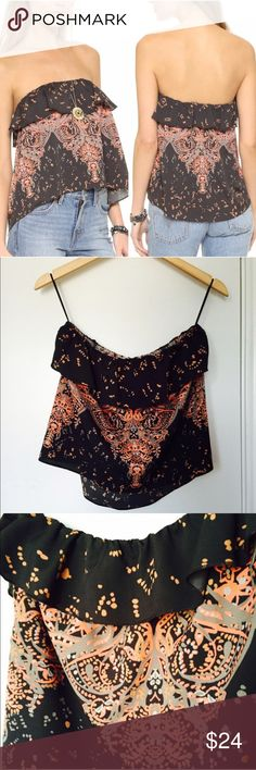 Free People Flounce Printed Ruffle Tube Top Brand New! Tag was ripped off by accident. Never worn, excellent condition. Ruffle trim, Bandeau neckline with elastic trim. 100% polyester. 15 inches long. FP size small- fits a 2-6. Free People Tops