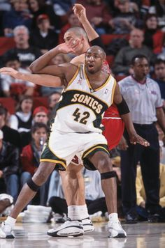 f7f1308e057 Forward Vin Baker of the Seattle SuperSonics and center Dalibor Bagaric of  the Chicago Bulls fight for position during the NBA game at Key Arena in.