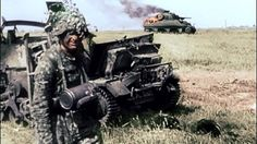 A Waffen-SS soldier and a destroyed american sherman and other vehicle. Normandy, summer 1944