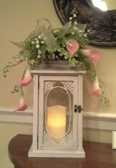 Lantern for spring. Great alternative to sending flowers for funeral and other occasions. Lantern and candle from Kirklands.
