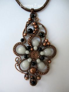 Wired flower pendant - love the combination of beads and wire.  This link also has pictures of some other great pieces