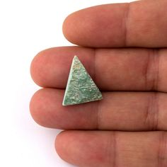 *18,50mm x 16,50mm x 5,20mm  *Raw sliced triangle fuksite  GENERAL INFORMATION STONES; *Raw rough stone shaped without touching the surface of the stone,that way you get the original texture of the gemstone. *We can do custom Works,such as specific size or shape,another Stone that we do not list might be avaliable or possible,please ask your need and we will return you in 3 business days, BEADS; *We can do custom Works such as specific size or shape connectors,or beads,locks,or chains pls…