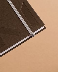 Notepad with fabric cover and blind deboss detail for Mellbye designed by Heydays.