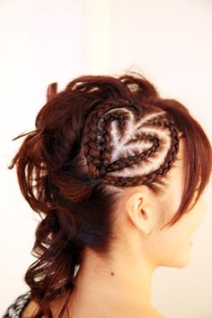 Cornrows heart-shaped and curls crazy! This would be cute valentines hair for a little girl