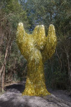 Golden Beast by Troy Emery High-density taxidermy foam, PVC tinsel, polyurethane adhesive, steel rods
