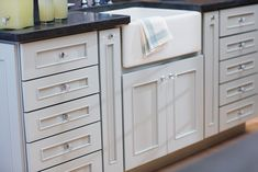 An apron sink is an attractive focal point and looks beautiful in the kitchen island. - Dura Supreme Cabinetry