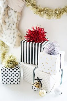 Make your presents pop with festive pom-pom toppers. #DIY