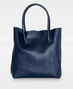 plain tote in navy is a tote bag made of full grained leather with a natural, smooth structure. This bag has no lining but a small leather compartment inside. It is a reinterpretation of our iconic 104 Working bag. The tote is perfect for everyday Smooth Leather, Blues, Handbags, Tote Bag, Navy Bags, Elsa, Boutique, Heart, Purses