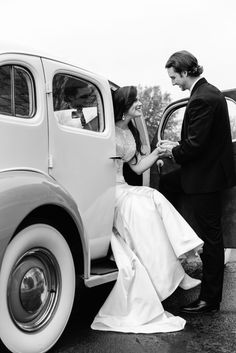 Bride + groom leaving in a vintage car from the Wedding Reception