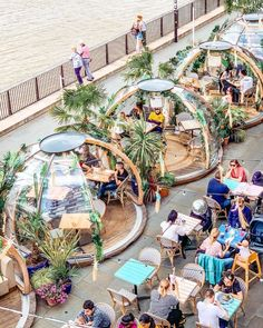 These cozy winter igloos transform into tropical surfer shacks in the s. - London…These cozy winter igloos transform into tropical surfer shacks in the summer! Tag a friend you'd want to have drinks here with. Design D'espace Public, Outdoor Restaurant, Landscape Architecture Design, Urban Architecture, Restaurant Interior Design, Cafe Design, Travel And Leisure, Parks, Beautiful Places