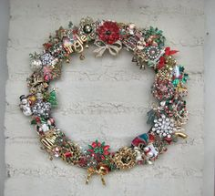 Vintage Christmas brooch wreath: make base and pin my collection to it as storage method - place in shadowbox type frame; unpin to wear