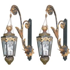 Pair of Gilt Wrought Iron Chandeliers with Gilt Brackets | From a unique collection of antique and modern lanterns at http://www.1stdibs.com/furniture/lighting/lanterns/