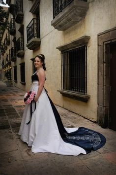 Taken from my own bridal shoot. Shot by Rawlinson Photography-Ft. Worth. Location: Canals at Las Colinas  Can't recall what the designer of the dress is, I just no it's no longer available since my wedding was in 2010.