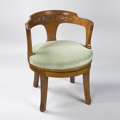 A French Art Nouveau wooden desk swivel armchair by Eugène Vallin. Circa: 1900