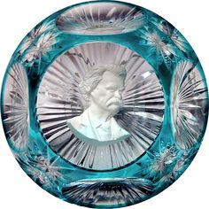 """Mark Twain sulphide paperweight - France by Cristal D'Albret. This paperweight is dated 1969 By French Sculptor Gilbert Poillerat, . Base with a starburst cut base and seven perimeter panels. 2-3/4"""" in diameter, stands 1-5/8"""","""