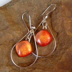 Fused Glass Earrings Coral Sunset Sterling and by GlassCat on Etsy, $25.00. Love the look, but would want a different color