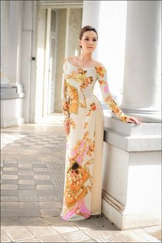 A beige ao dai with mustard yellow flowers would be beautiful!