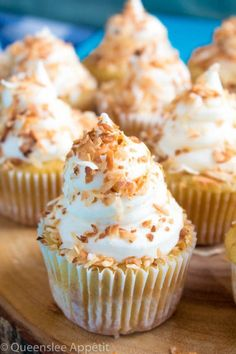 Coconut Cream Pie Cupcakes — moist, light and airy coconut cupcakes filled with coconut custard and topped with creamy coconut frosting and toasted coconut.