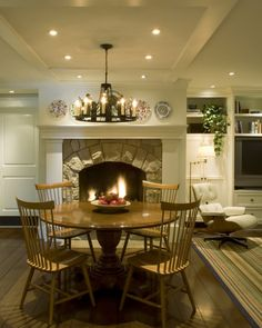 Cottage Modern -fireplace in kitchen Instead of a table and chairs I would have 4 comfy leather chairs & maybe a round coffee table. Faux Fireplace, Modern Fireplace, Kitchen Fireplaces, Fireplace Ideas, Wrought Iron Patio Chairs, Home Decor Kitchen, Cozy Kitchen, Kitchen Ideas, Kitchen Styling
