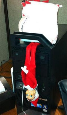 Our office elf's name is Stanley.  Here he is just hanging around, and it's only his first day on the job!