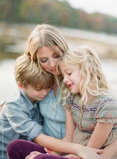 Mother and her two children by martalocklear | Stocksy United
