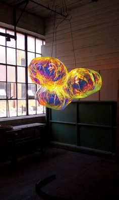 """""""Adam Jackson Pollock's Astro Puff suspension lamps in dichroic film and stainless steel by Fire Farm. Interior Design Magazine, Interior Design Inspiration, Cool Lighting, Lighting Design, Lighting Ideas, Laminated Glass, Touch Lamp, I Love Lamp, Dichroic Glass"""