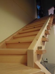 Housed timber stair with double wedge holding joinery, finished with Rubio Monocoat system