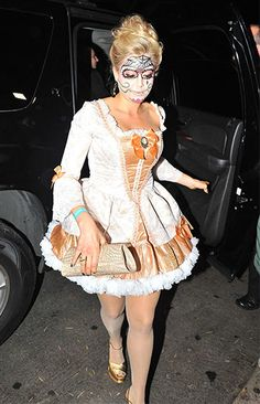 Kate Upton went all out in her cute white and orange dress and her Day of the Dead-esque makeup.