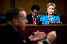 Hilary Clinton at a Defense meeting, looking serious