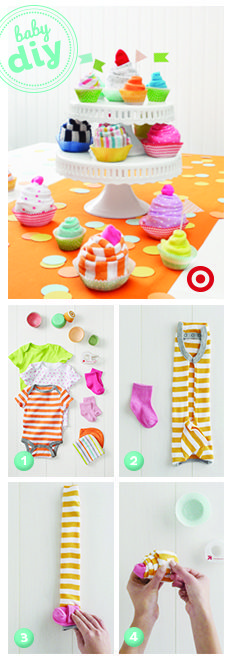 cupcake shower gift made up of baby layette items....such a cute idea