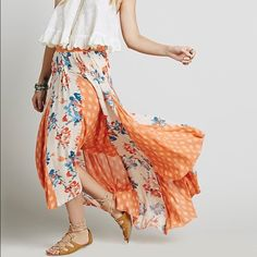 Free People Hi-Lo Long Skirt Free People Hi-Lo Long Skirt size small. 100% rayon, fun unfinished bottom. Great condition only worn a few times. Free People Skirts